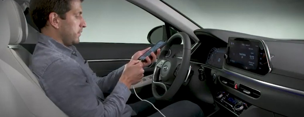 A man using smartphone integration in a Hyundai vehicle