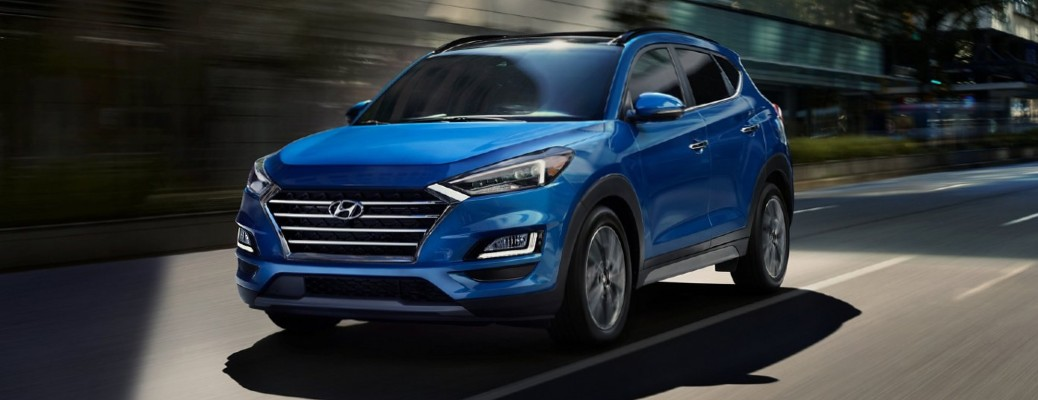 Driver's side front angle view of blue 2021 Hyundai Tucson