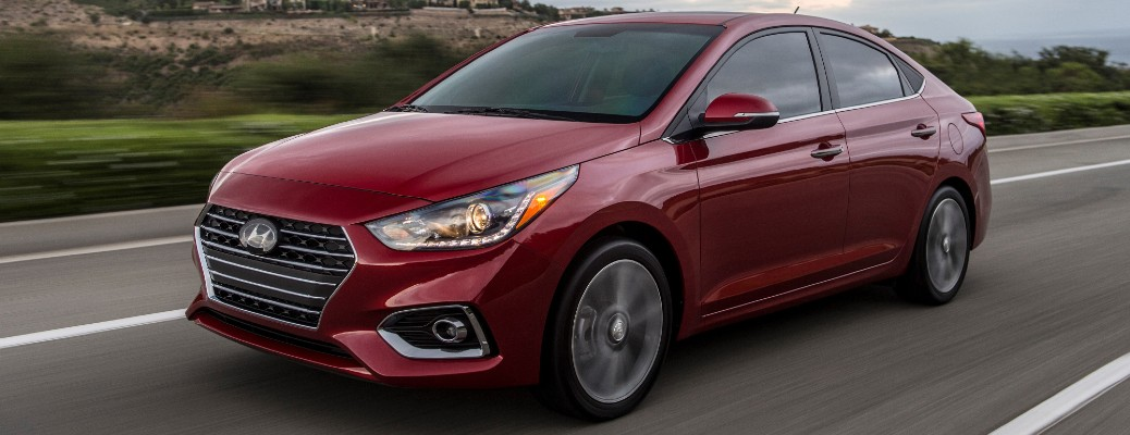 Driver's side front angle view of red 2021 Hyundai Accent