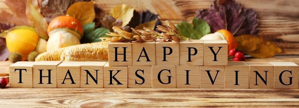 Blocks Spelling Happy Thanksgiving with Fall Background