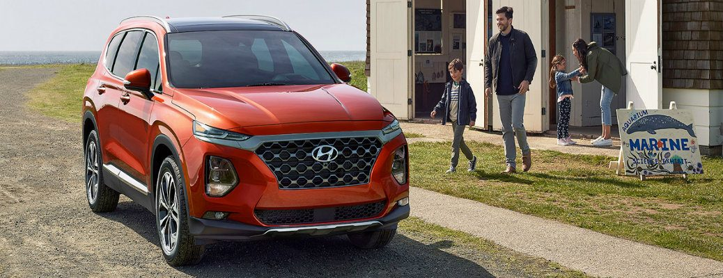 2020 Hyundai Santa Fe parked outside of a home with a family approaching