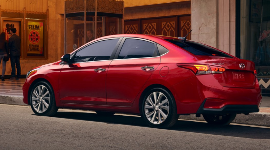 2020 Hyundai Accent exterior rear fascia driver side on side of road with people on sidewalk