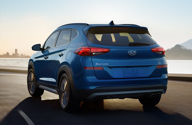 2020 Hyundai Tucson exterior rear fascia driver side on highway with city in distance