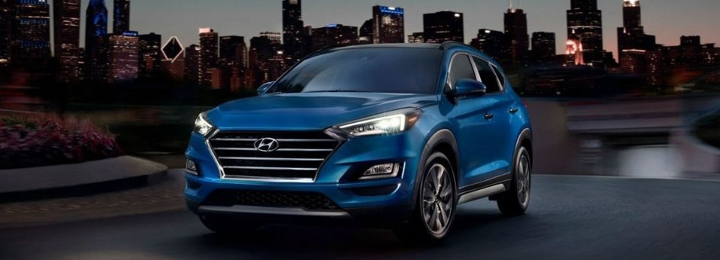 2021 Hyundai Tucson exterior front fascia driver side in city at night