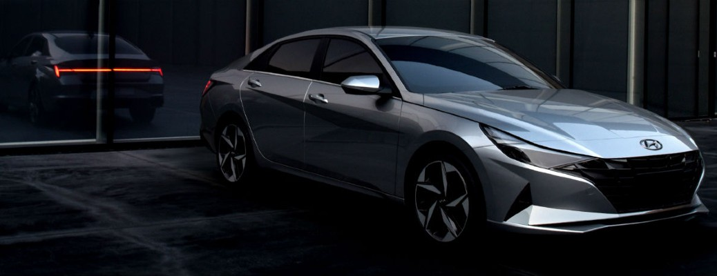 The front and side view of a silver 2021 Hyundai Elantra.