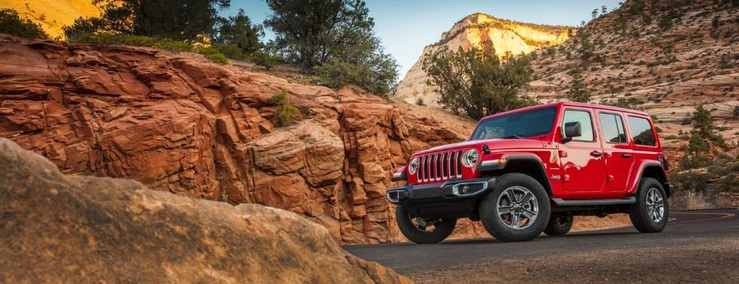 2020 Jeep Wrangler parked near exposed rock