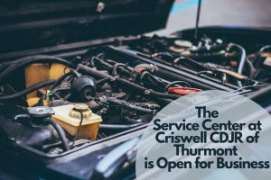 Engine with text saying The Service Center at Criswell CDJR is Open for Business