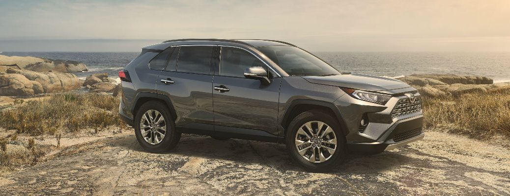 2019 Toyota RAV4 Side View with Ocean and Sunset Background