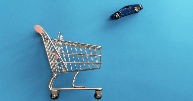 toy car flying into a shopping cart
