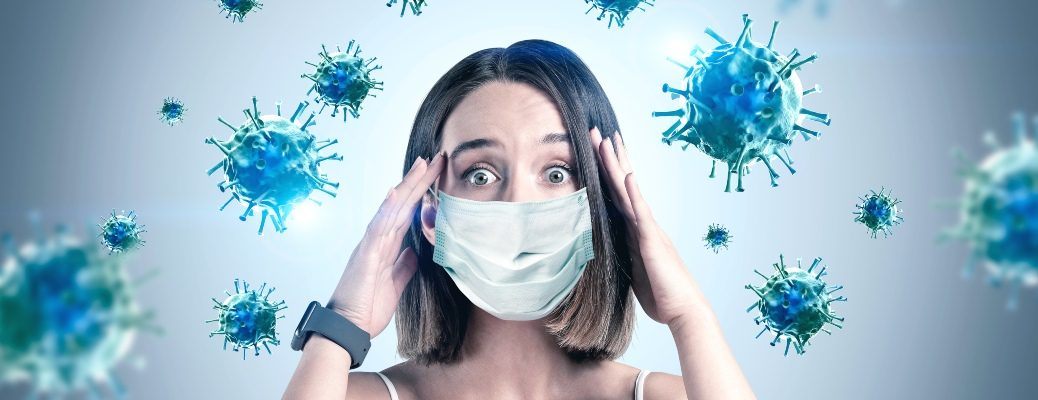 woman with face mask and coronavirus molecules charging