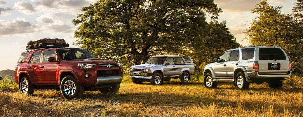 2020 Toyota 4Runner in red with classic 4Runner models behind
