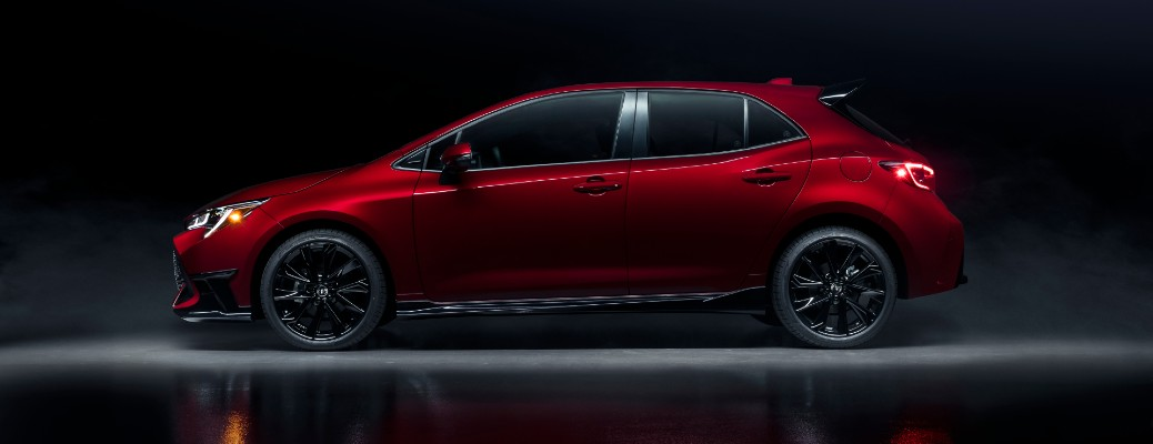 2021 Toyota Corolla Hatchback Special Edition exterior side shot promo image with Supersonic Red paint color