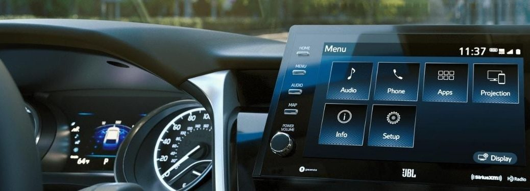 2021 Toyota Camry interior front cabin close up of touchscreen and partial steering wheel