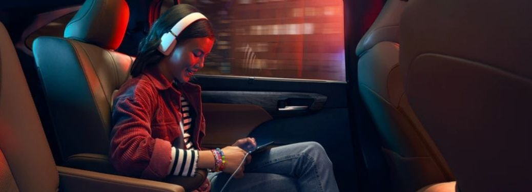 Girl in 2021 Toyota Highlander Using Wi-Fi Connect