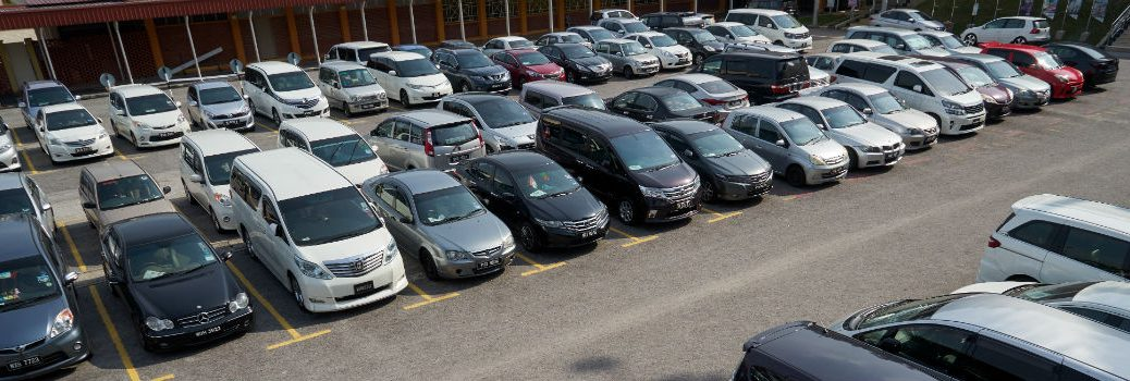 Multiple Rows of Used Vehicles in a Lot