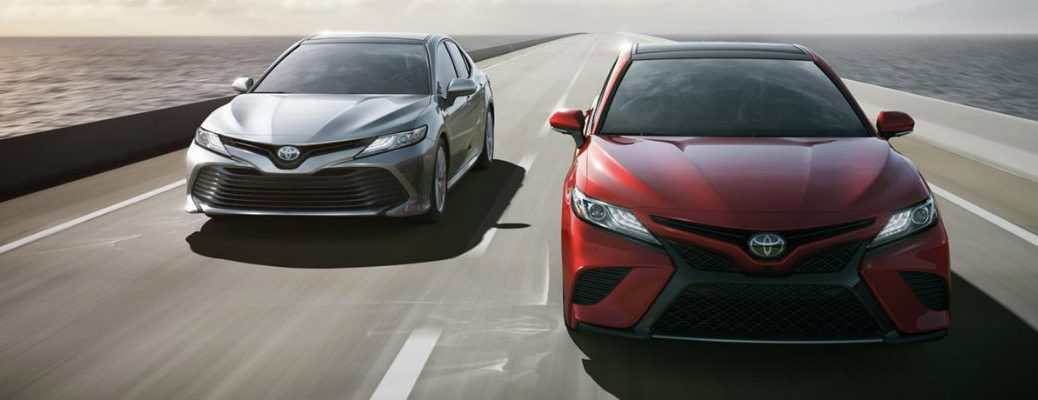 Two 2018 Toyota Camry models driving next to each other