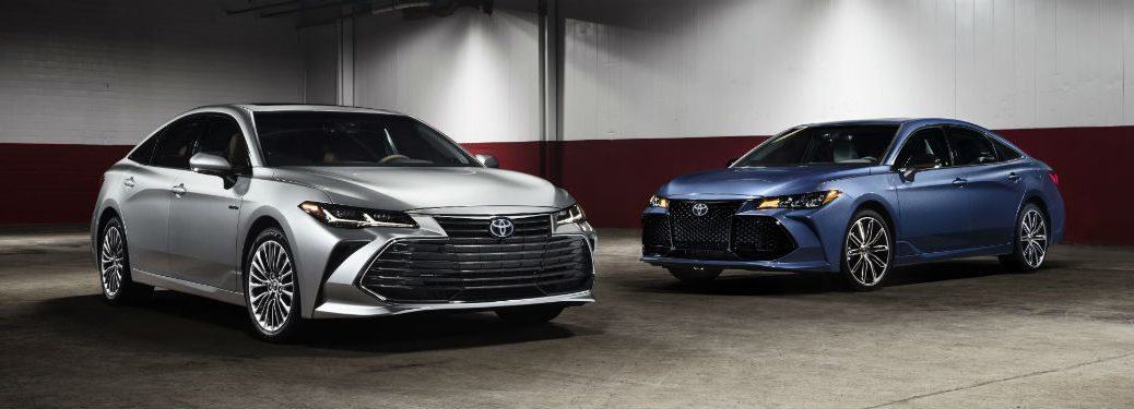 2019 Toyota Avalon metallic silver and metallic blue white and red walls background