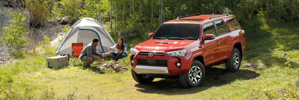 2020 Toyots 4Runner parked in the woods with a tent next to it
