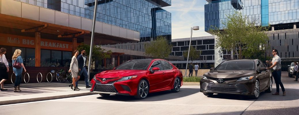 Two 2020 Toyota Camrys parked outside