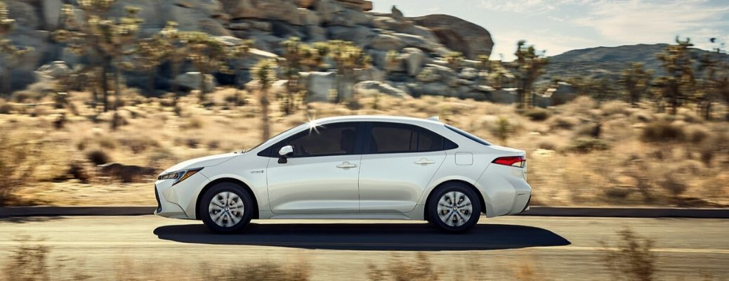 2020 Toyota Corolla side view driving in desert