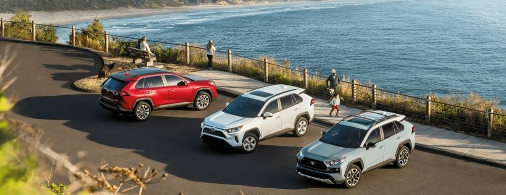 Three 2020 Toyota RAV4s parked near the water