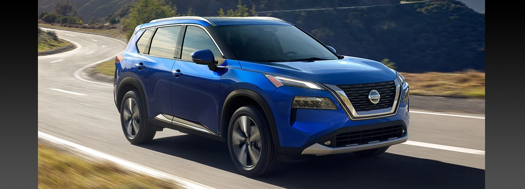 Blue 2021 Nissan Rogue Traveling Down Curvy Road