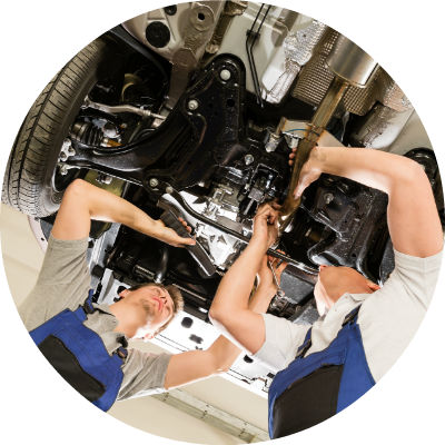 service technicians working on vehicle