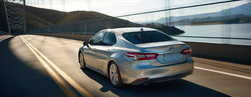 silver 2018 Toyota Camry driving on road