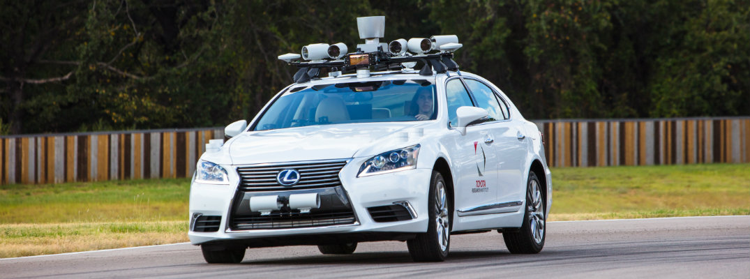 What are Toyota's Guardian and Chauffeur Autonomous Driving Modes?