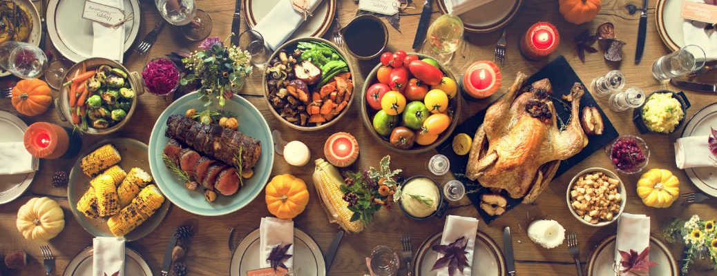 table-filled-with-Thanksgiving-food-and-dishes