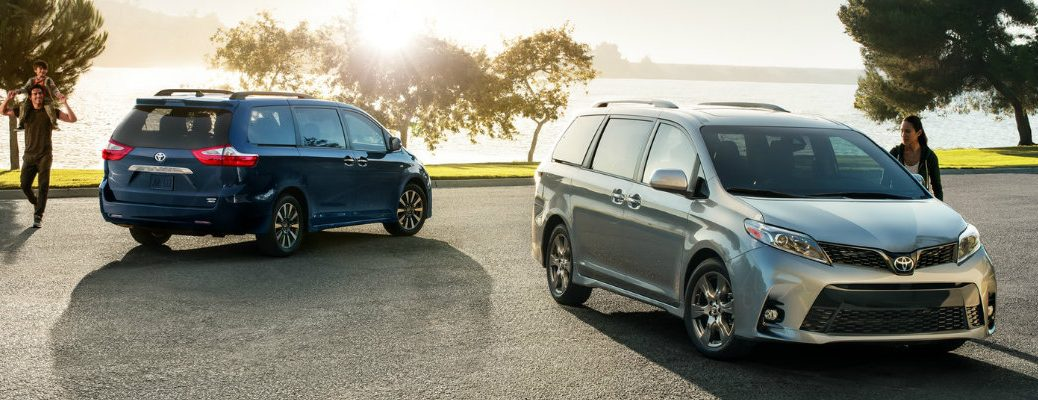 blue-and-silver-2018-Toyota-Sienna-models-parked-next-to-body-of-water