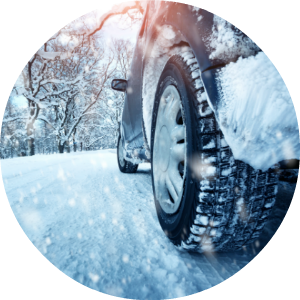 car tires driving on snow-covered road