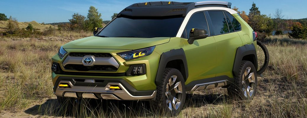 bright-green-Future-Toyota-Adventure-Concept-vehicle-parked-in-long-grass