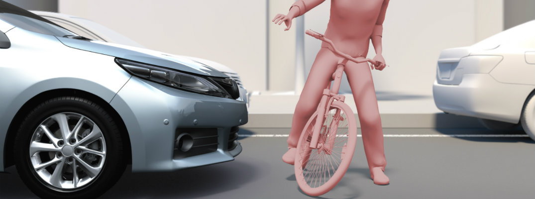 pink-animated-figure-on-a-bike-demonstrates-Toyota-Safety-Sense-Stopping-vehicle-for-a-bicyclist
