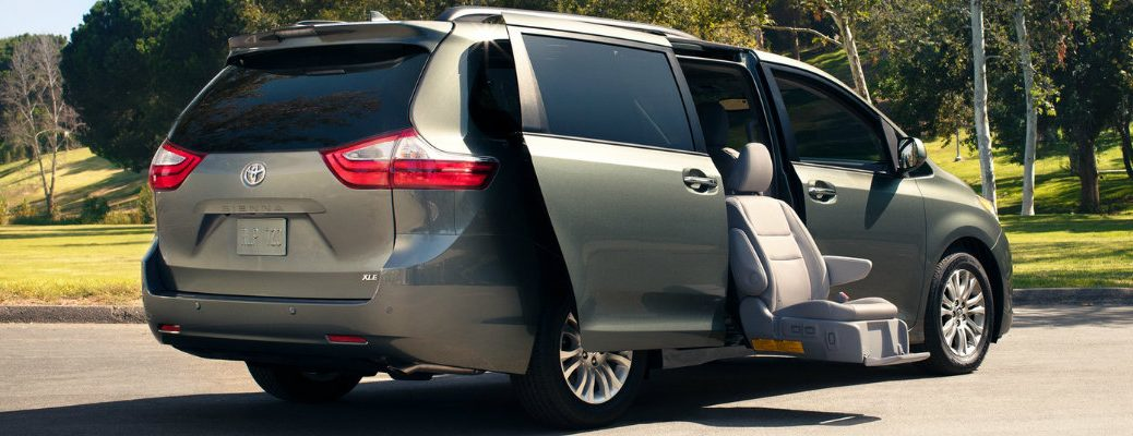 tan-2018-Toyota-Sienna-with-Auto-Access-Seat-extended-from-the-vehicle-and-lowering-to-the-ground