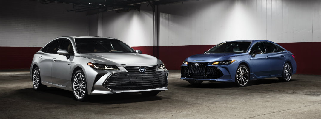 silver-and-blue-2019-Toyota-Avalon-models-parked-in-larger-indoor-area