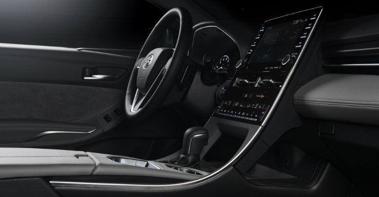 center-console-and-steering-wheel-in-2019-Toyota-Avalon-view-from-front-passenger-seat