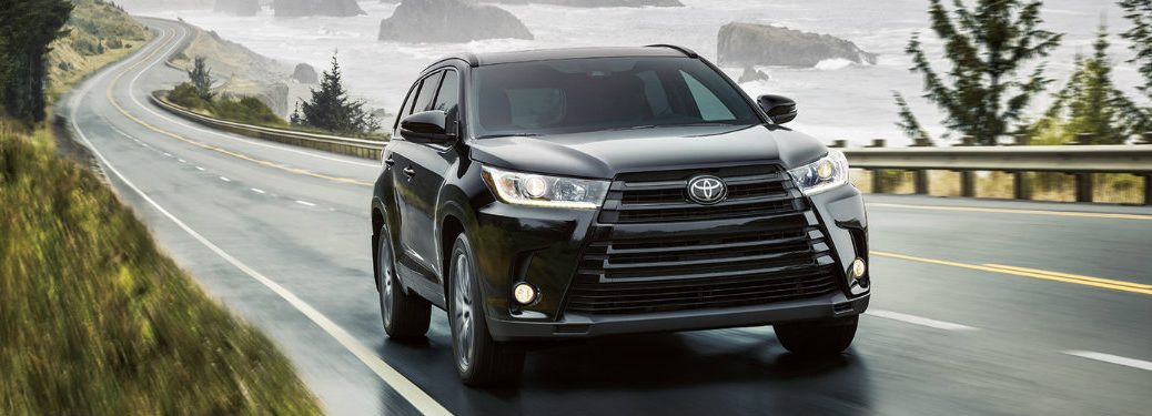 black-2018-Toyota-Highlander-driving-along-the-coast-in-the-rain