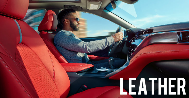 Cockpit-Red-leather-front-seats-with-man-driving-2018-Toyota-Camry
