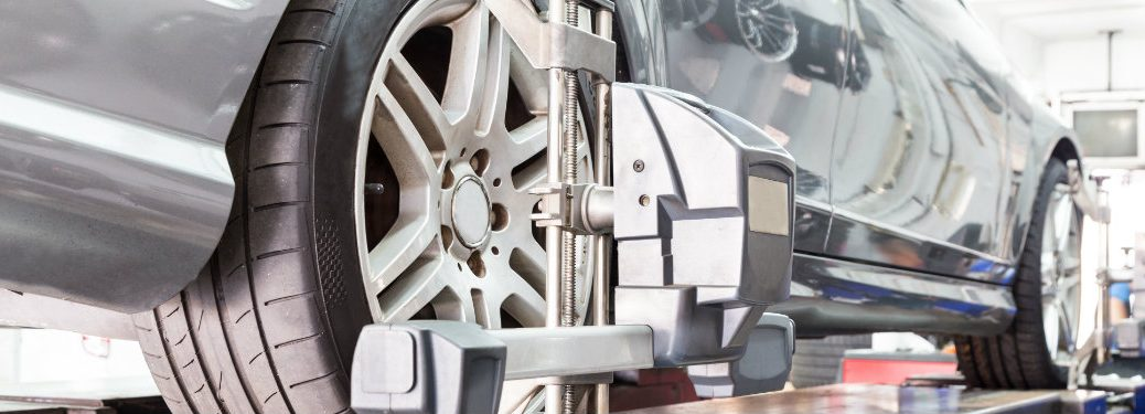 closeup-of-wheel-alignment-tool-clamped-on-car-wheel