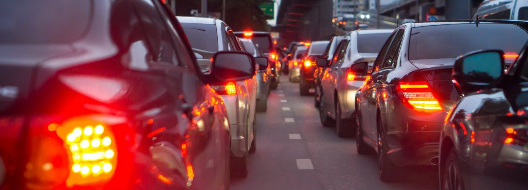 two-lanes-of-cars-backed-up-in-traffic-with-brake-lights