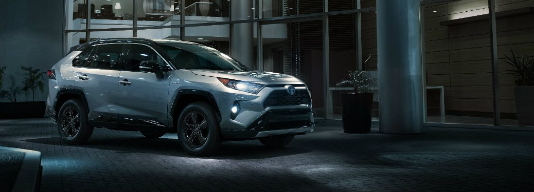 silver-2019-Toyota-RAV4-parked-outside-modern-home-at-night