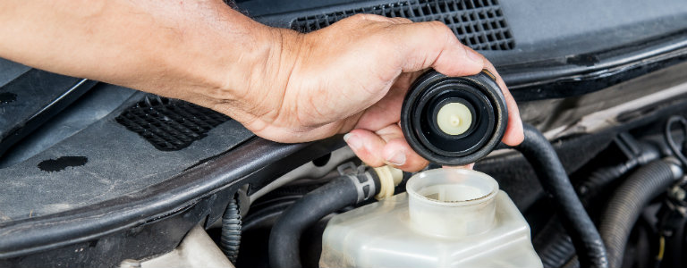 mechanics-hand-opening-brake-fluid-compartment