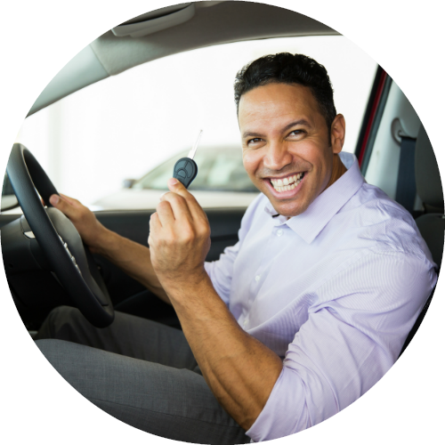happy male driver holding car key