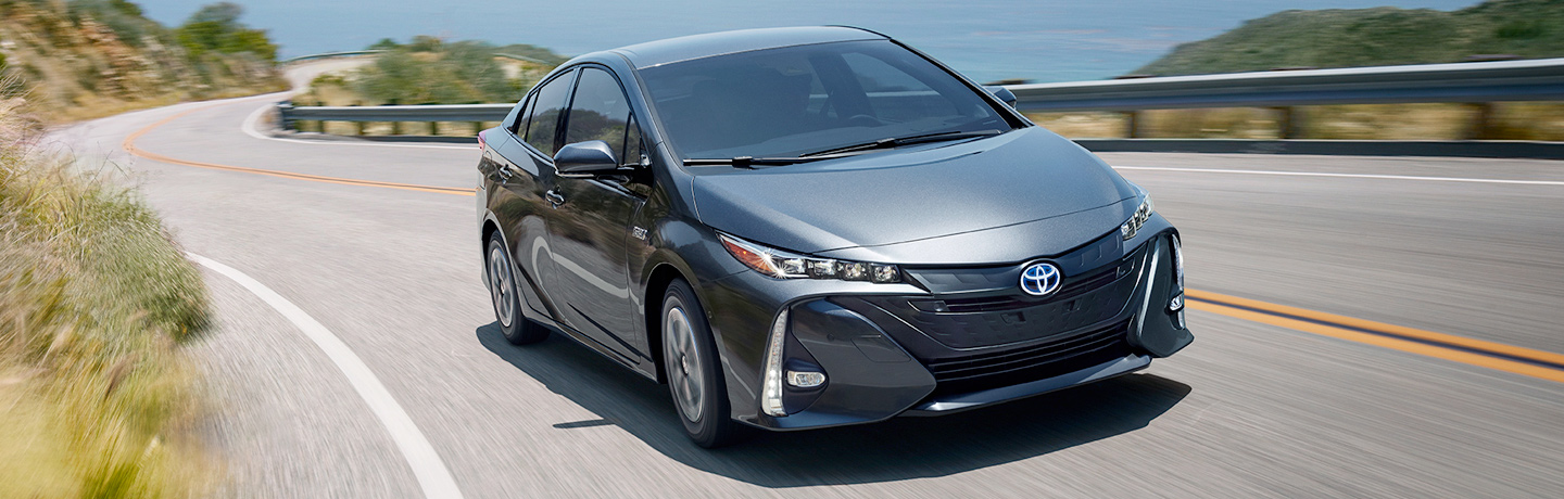 front view of 2017 Toyota Prius Prime driving along coastal highway