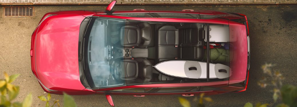 2019-Toyota-RAV4-in-Ruby-Flare-Pearl-view-from-the-top-with-transparent-roof-showing-surfboard-in-cargo-area