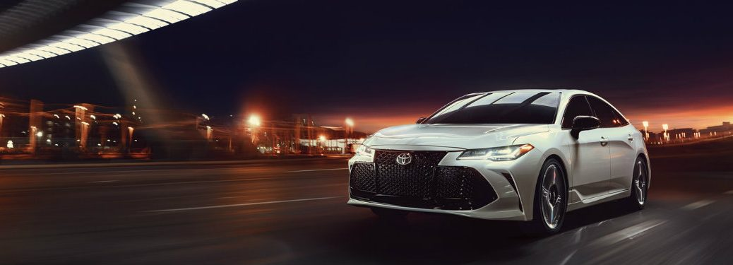 silver-2019-Toyota-Avalon-driving-along-highway-at-night