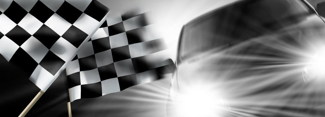 checkered-flags-with-generic-racing-car-with-headlights-on