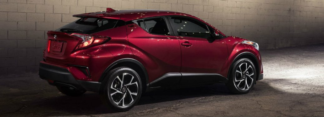red-2019-Toyota-C-HR-parked-in-shadowy-garage