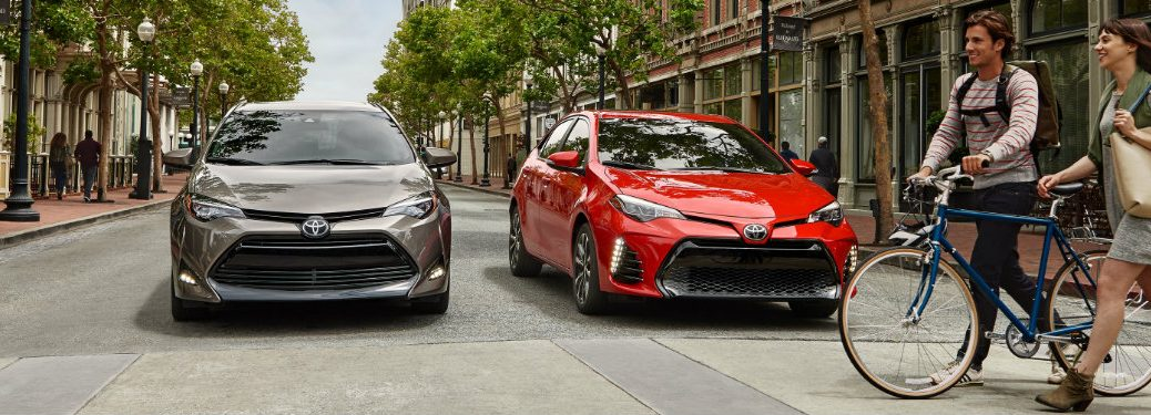 brown-and-red-2019-Toyota-Corolla-models-stopped-at-crosswalk